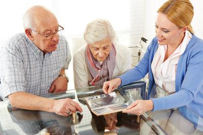 caregiver giver medicine to the elder